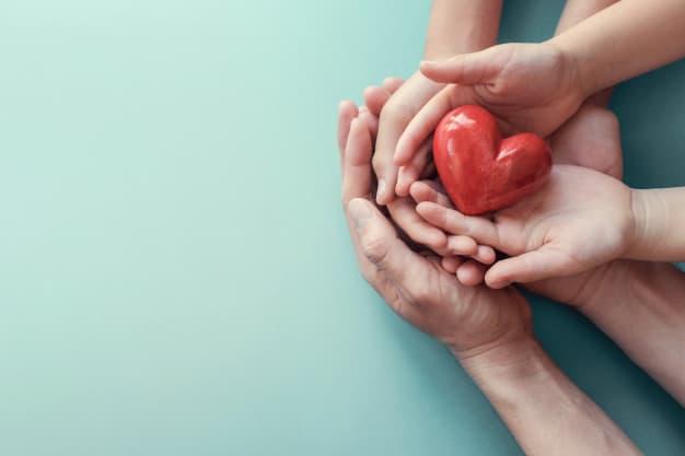 בסט לינק – freepikadult-child-hands-holding-red-heart-aqua-background_49149-908
